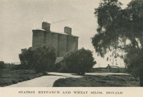 Station entrance and wheat silos, Donald, 1949