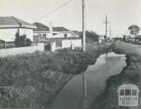 An unsewered area, where street channels are used to dispose of kitchen and laundry wastes, Melbourne, 1955