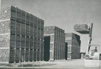 Fork lift truck stacking timber for air drying, Heyfield, 1955