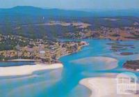 Aerial view of Mallacoota Camp Park and township from Bar