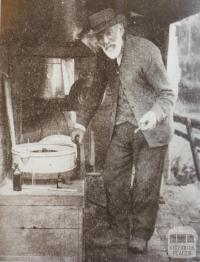 Mr Joseph Walker testing skim milk, Yinnar South, 1925