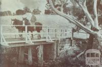 Man on horseback crossing wooden bridge, Bayswater, 1947