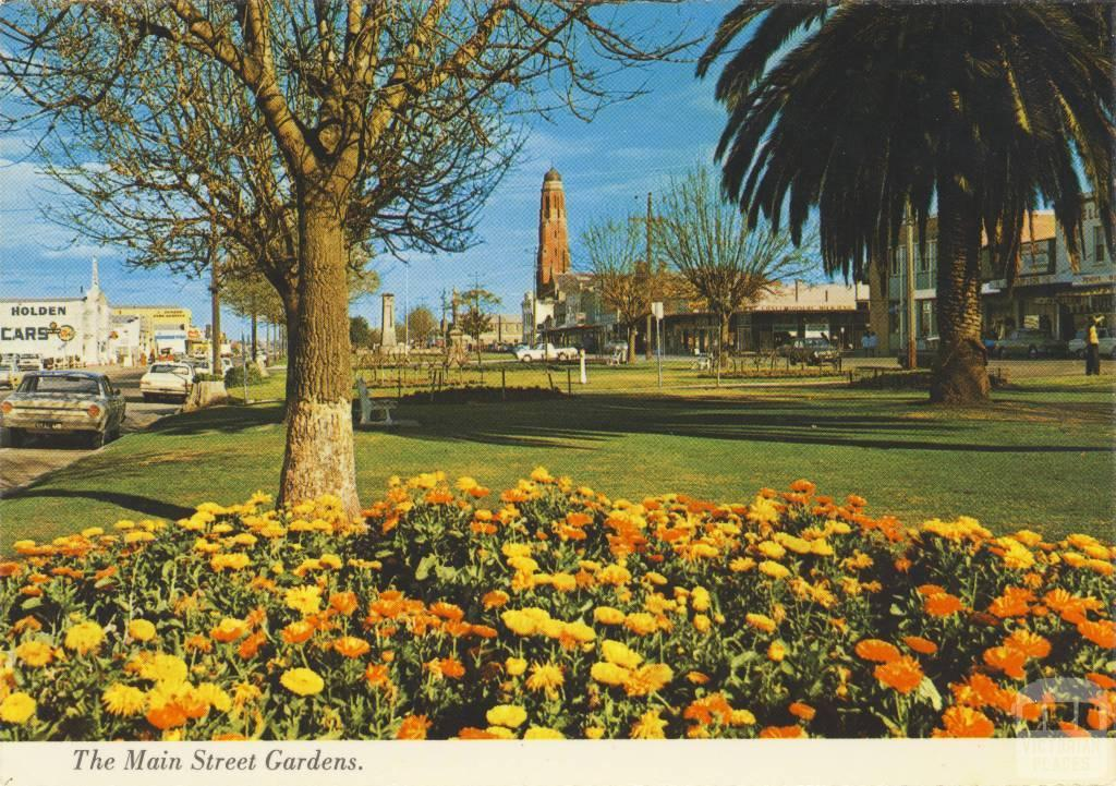 Spacious Gardens in Main Street looking to St Mary's Church, Bairnsdale 1979